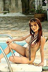 Seated Pulling Off Bikini Bottoms