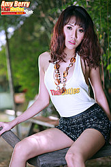Seated On Rocking Horse Long Hair Over Her Shoulders Wearing Necklace In Tshirt Wearing Short Skirt