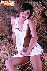 Sitting On Hay Bales Wearing Dungarees Short Hair