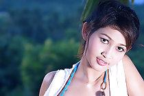 Cutie Tar Chang stripping on hamock baring pert small breasts