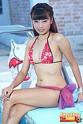 Seated On Edge Of Swimming Pool Wearing Bikini Legs Crossed