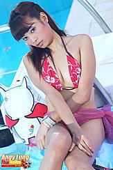 Seated Beside Pool Wearing Bikini Top Legs Pressed Together