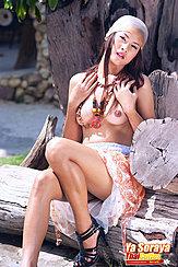 Seated On Log Topless Knee Raised Wearing High Heels