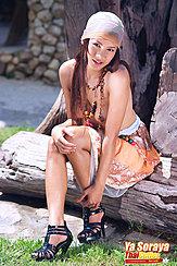 Sitting On Log Topless Leaning Forward Long Hair Hand On Knee Wearing Black High Heels
