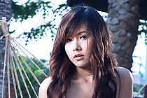 Pretty Miky Otaka stripping on hammock and fondling breasts