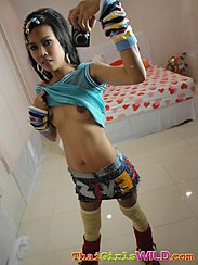 Raising Top Over Her Small Breasts Self Shot Picture Wearing Short Skirt