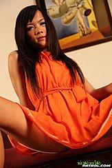 Seated In Orange Dress Long Hair Legs Spread Wide