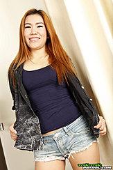 Long Hair Over Her Jacket Wearing Denim Shorts