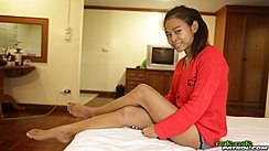 Jan Sitting On Bed Legs Crossed Bare Feet Painted Toenails