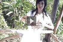 Yoko dancing and exposing her small breasts